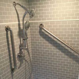 Grab bars in shower with grey walls