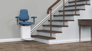 Straight stair lift with blue chair in modern home