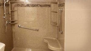 Accessible shower with grab bars and shower chair