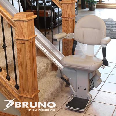 Bruno straight stairlift with empty chair ready at the bottom of staircase